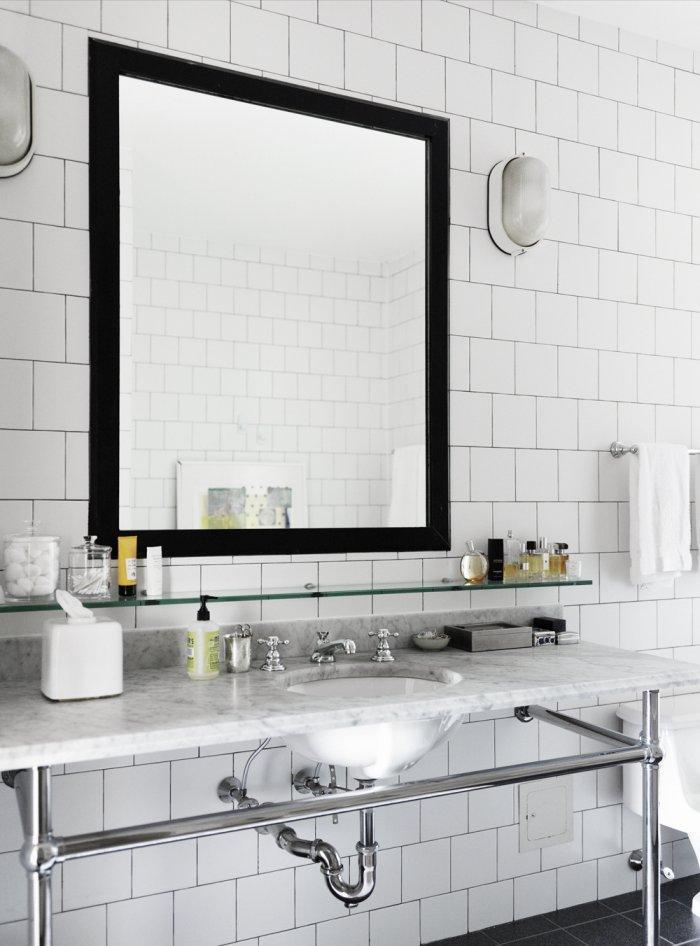 Mirror with black frame - in a modern small bathroom