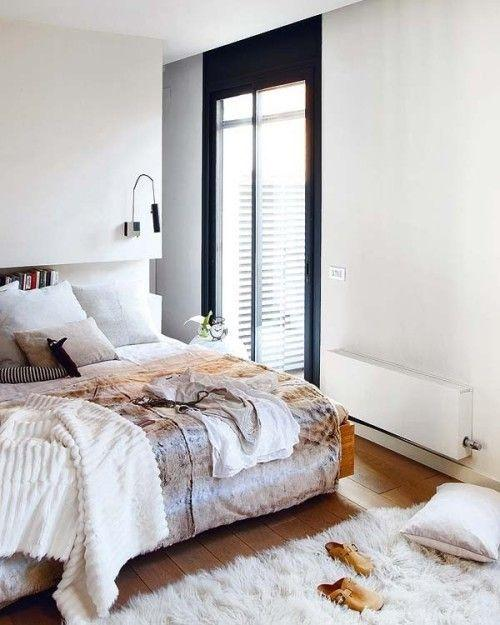 Modern apartment bedroom - with fluffy rug on the floor