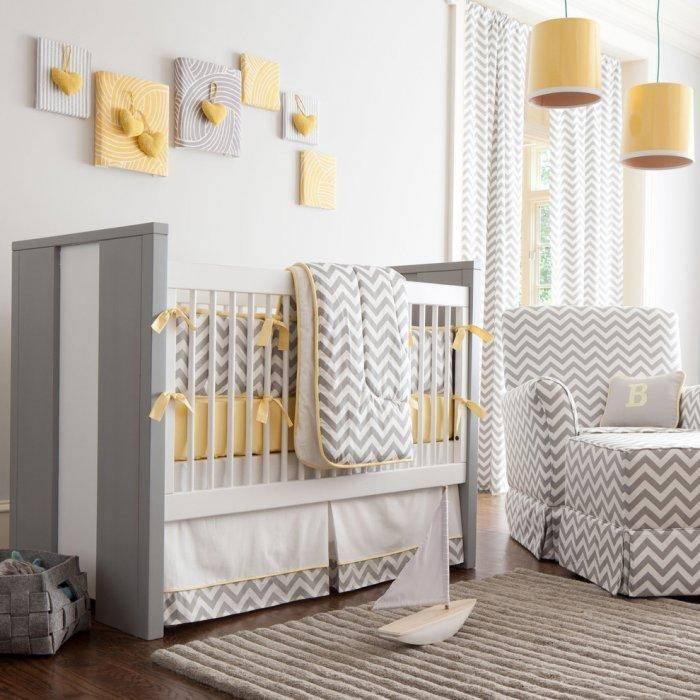 Modern baby crib - in a room with yellow pendants