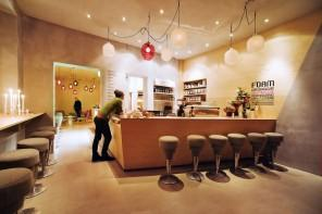 Modern cafe interior design with white contemporary bar stools