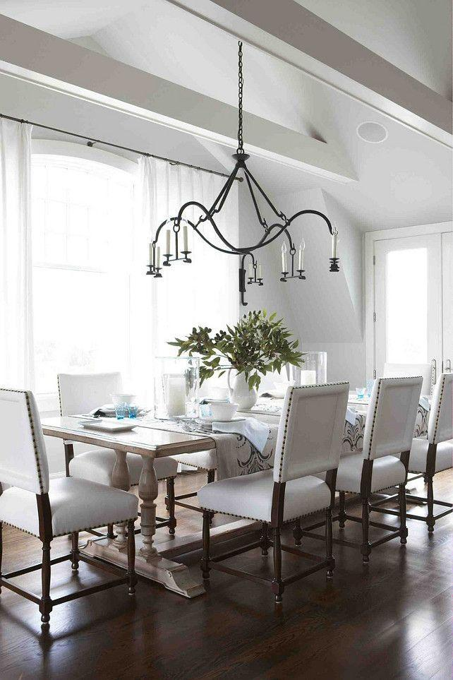 Modern dining room - with white chairs and wood floor