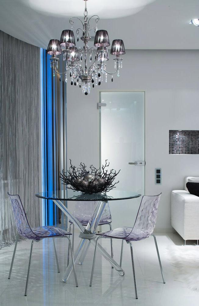 Modern eclectic small dining room - with glass round table and chairs