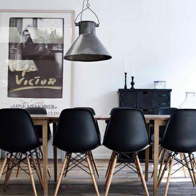 Modern Industrial Dining Room   With Black Chairs And Iron Pendant