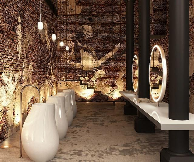 Modern industrial restaurant restroom - with ultra contemporary faucets and mirros