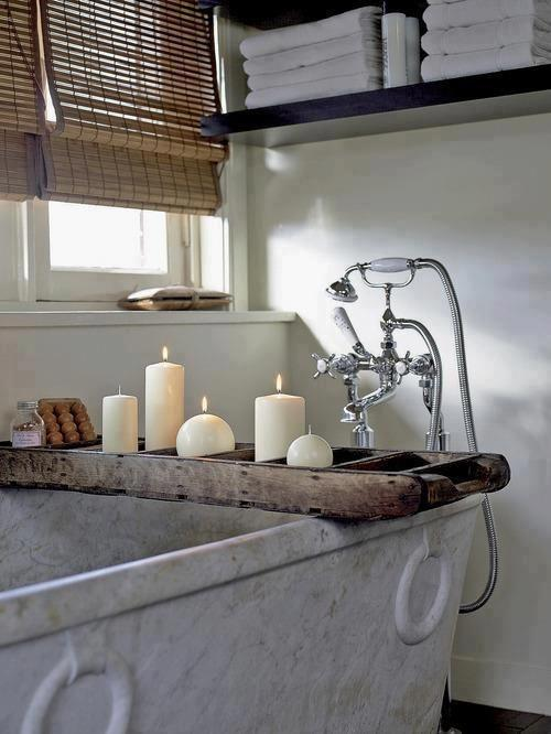 Modern rustic bath with candles - placed on a wooden stand