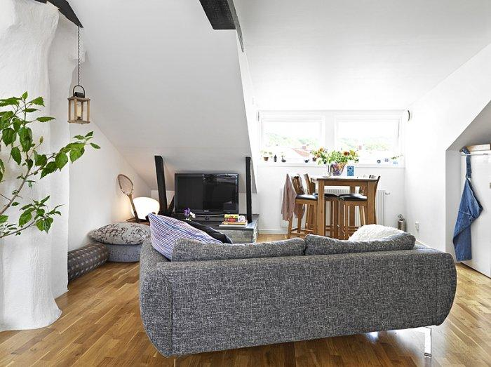 Modern small living room - with grey contemporary sofa and sloped ceiling
