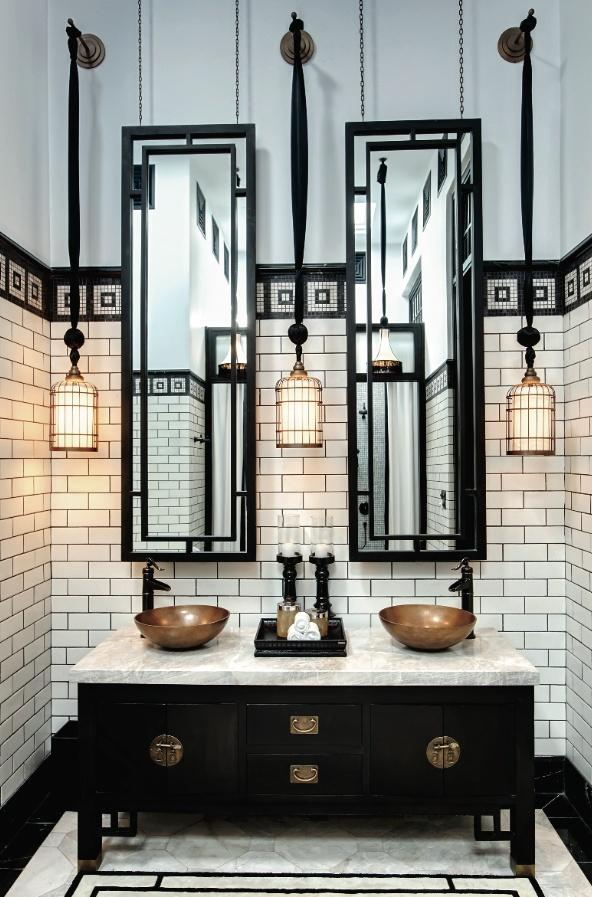 Modern traditional restroom - with round faucets and mirrors