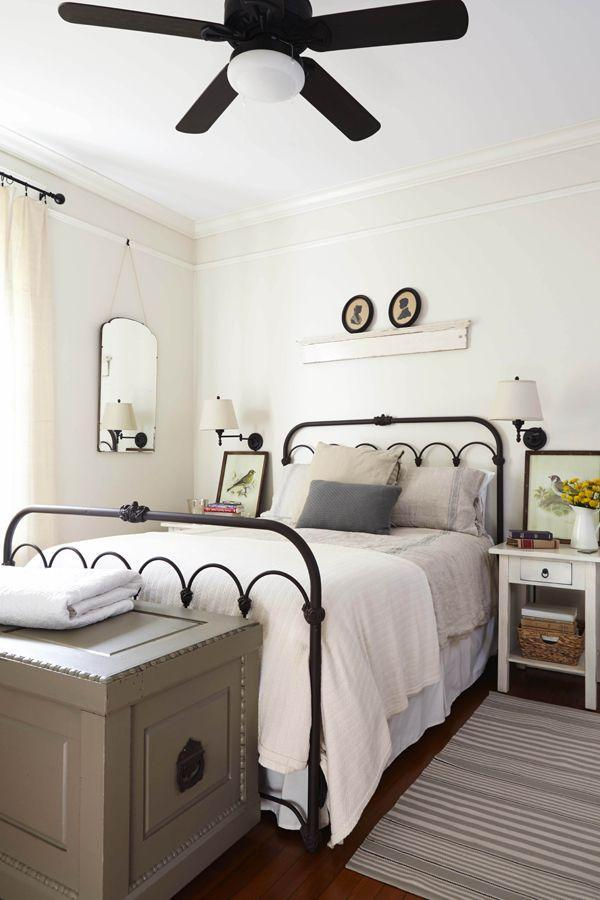 Modern vintage bedroom with black framed bed founterior Modern vintage master bedroom
