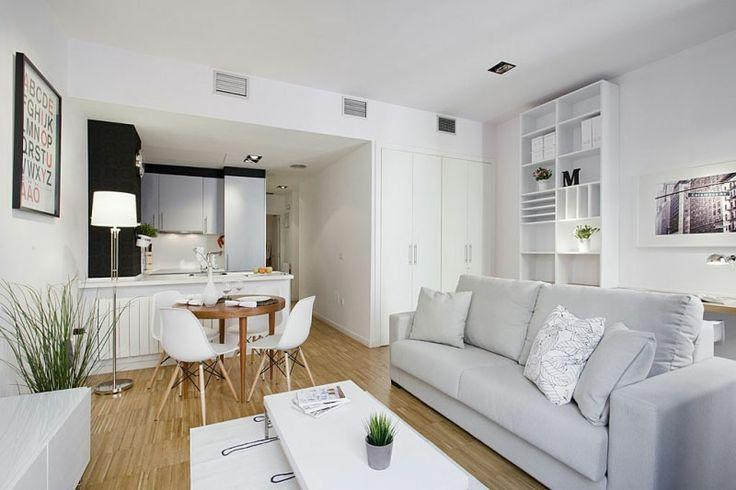 Modern white living room - with small dining table in the background