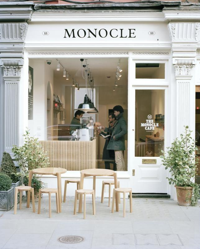 monocle coffee shop with small tables on the pavement - Coffee Shop Design Ideas