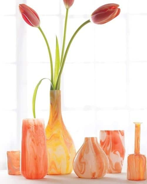 Orange vases - with tulips inside them