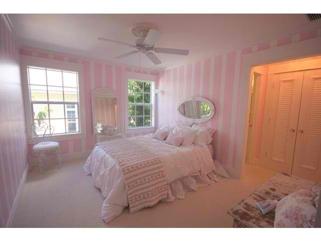 Pale Pink Bedroom With Stripe Painted Walls