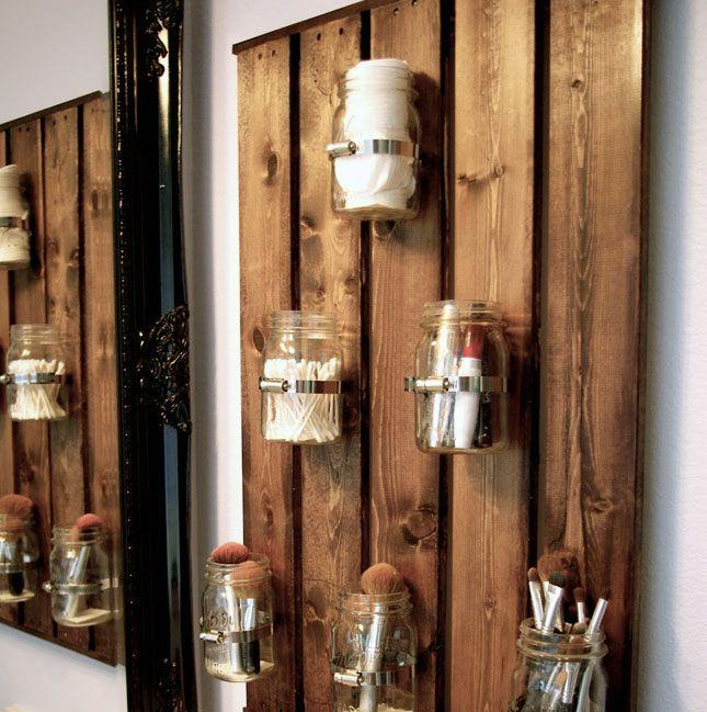 Pallet wall decor - with wood beams and hurricane jars