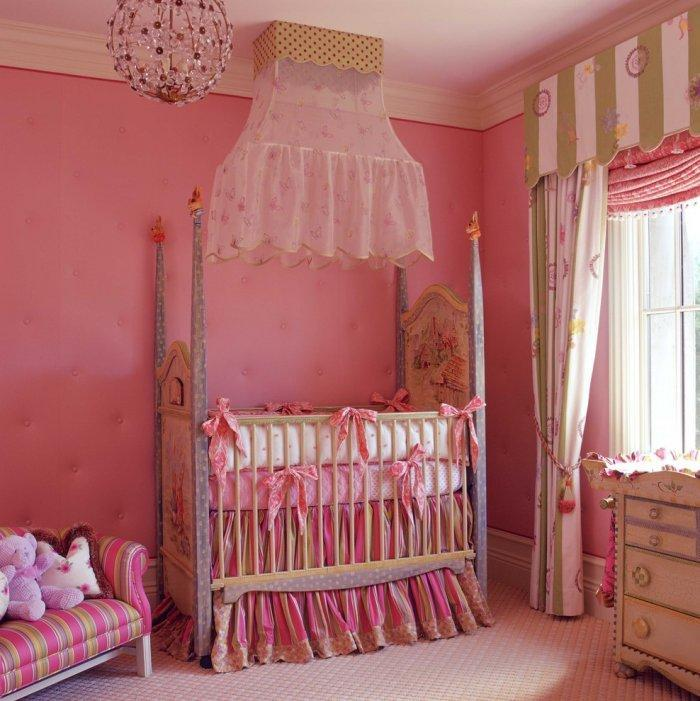 Pink baby crib - with decorative toys