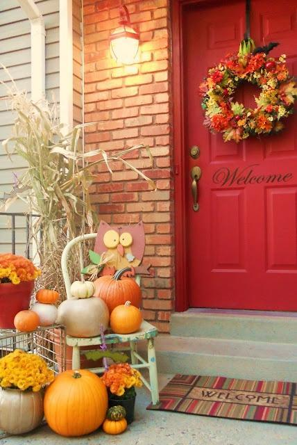 Red front door - with Halloween autumn decoration