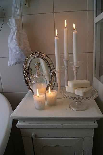 Romantic candles - inside a white vintage bathroom