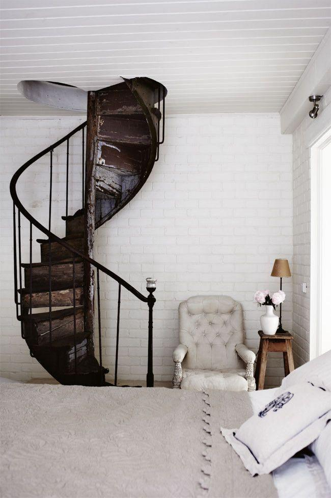 Rustic spiral staircase - painted in dark color