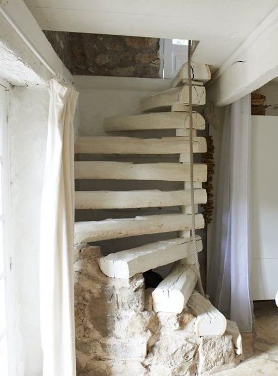 Rustic staircase design - with beams leading to the upper floor