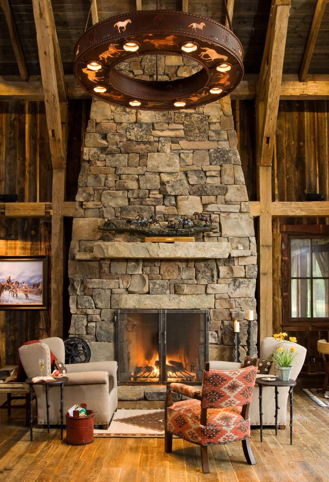 Rustic stone fireplace - inside a mountain lodge