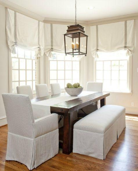 Simple traditional dining room - with white chairs and stools