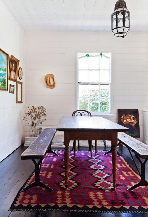 Small apartment dining room - with graphic rug and benches