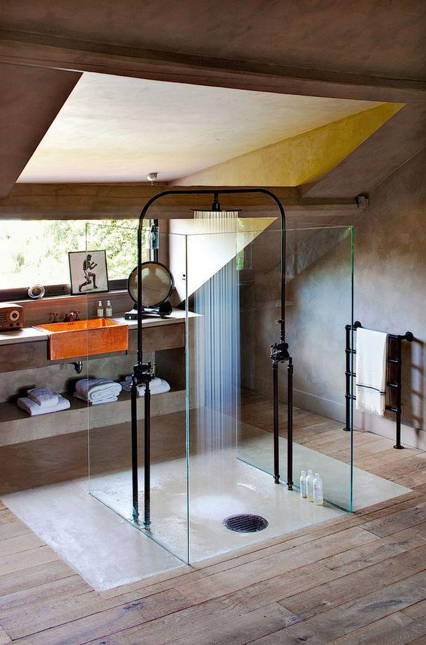 Small attic shower area - with walls made of glass