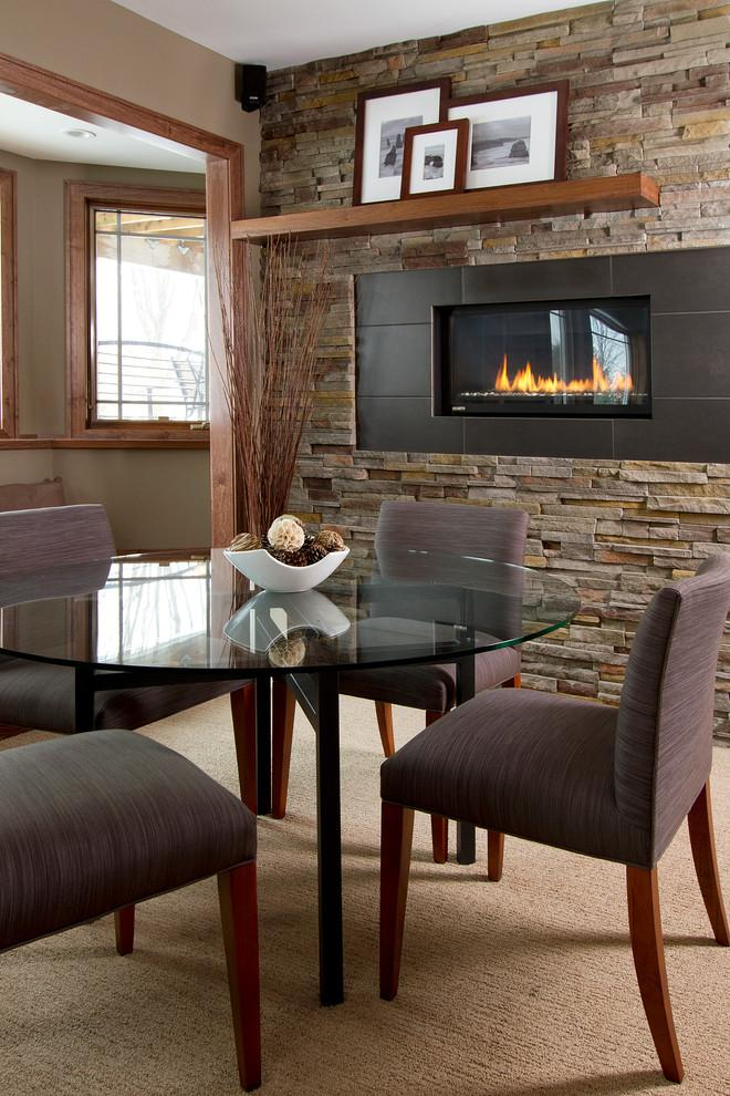 Small dining room and wall fireplace - with stone accents