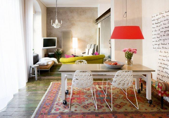 Small eclectic dining room - with colorful accents and red pendants