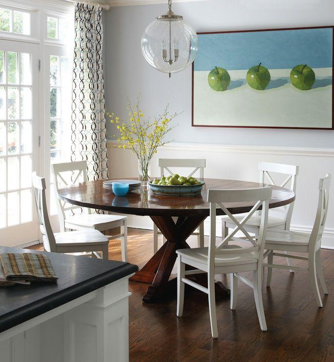 Small flat dining room - with round table and white chairs