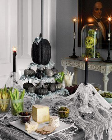 Spooky Halloween table setting - with a lot of spider nets
