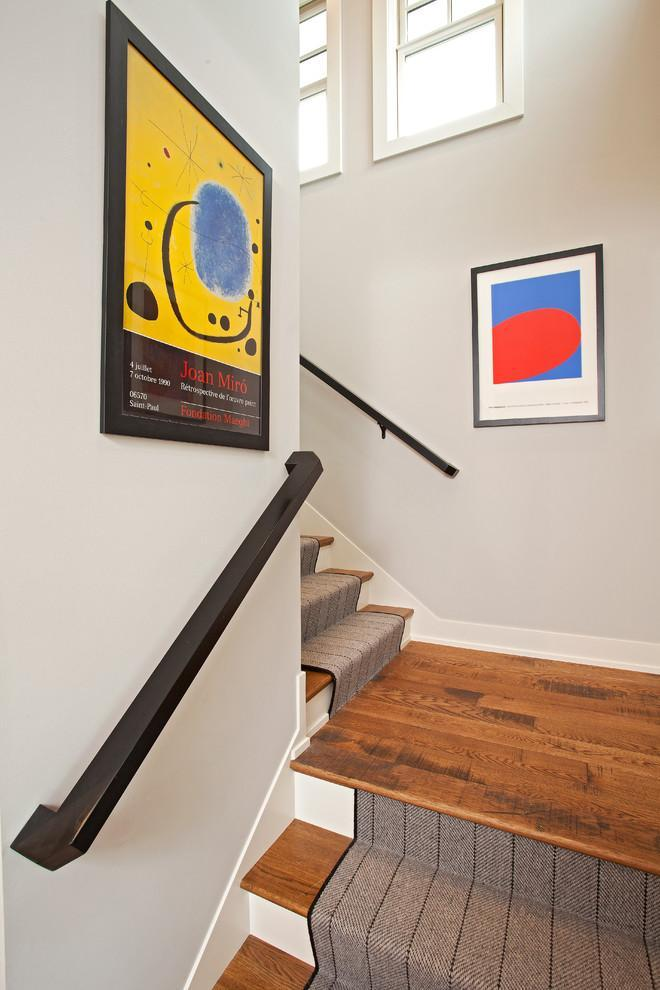 Stair runners on wood staircase - they complete the cozy look
