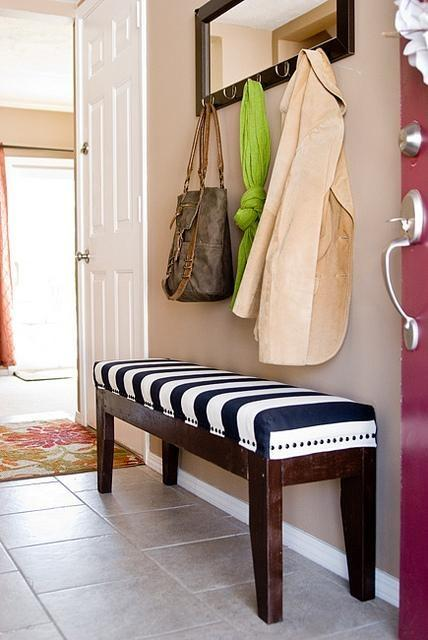 Striped entryway bench - and coat rack above it