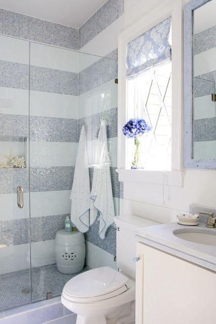 Stripes made of tiles - inside a pale colored bathroom