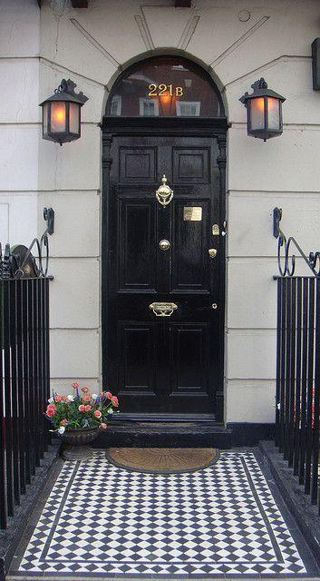 Stylish black front door - and a welcoming mat in front of it
