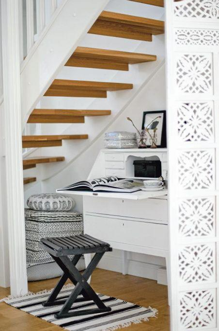 Stylish modern staircase - with white desk beneath
