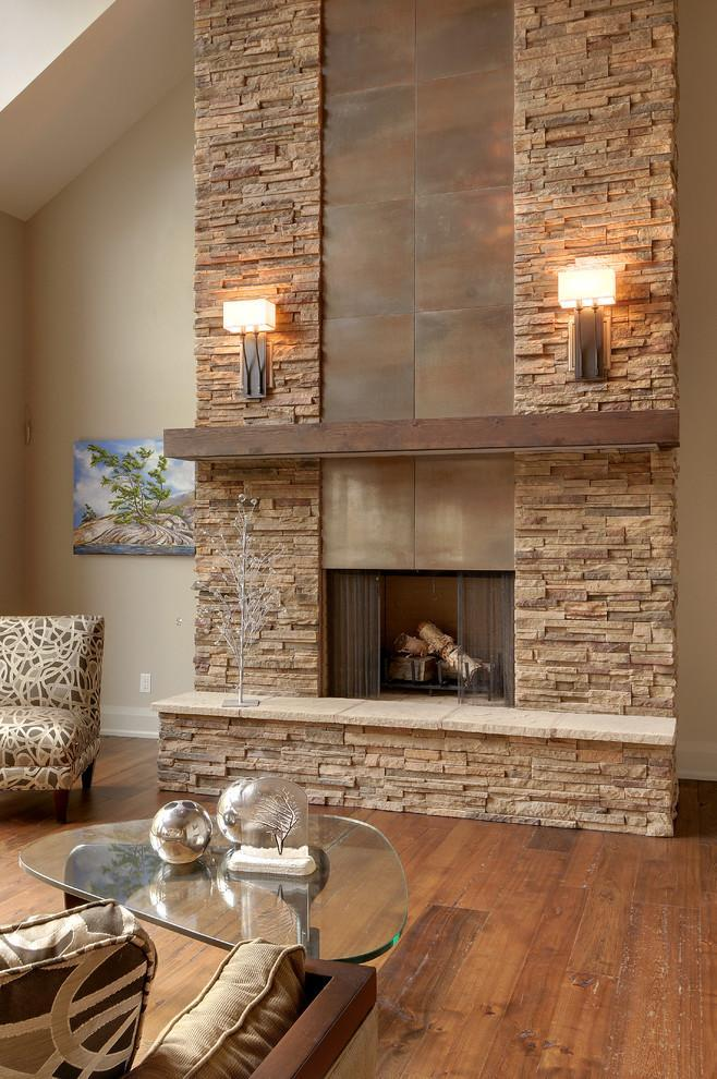 Stylish modern stone fireplace - with two lamps on both sides
