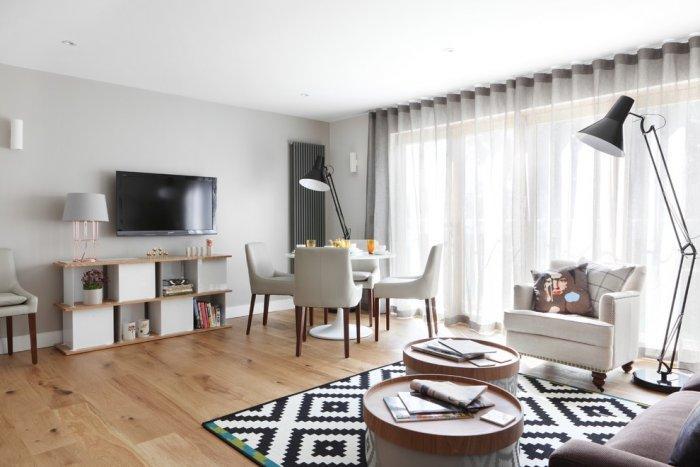 Stylish white bookcase - placed beneath the TV set