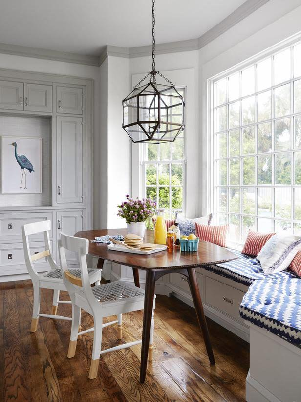 Sunny dining room - with small table, chairs and windowside sofa