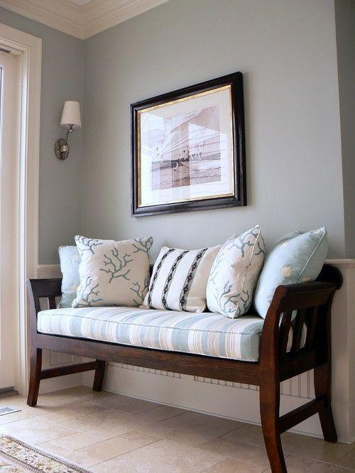 Traditional entryway bench - with pale cushions on it