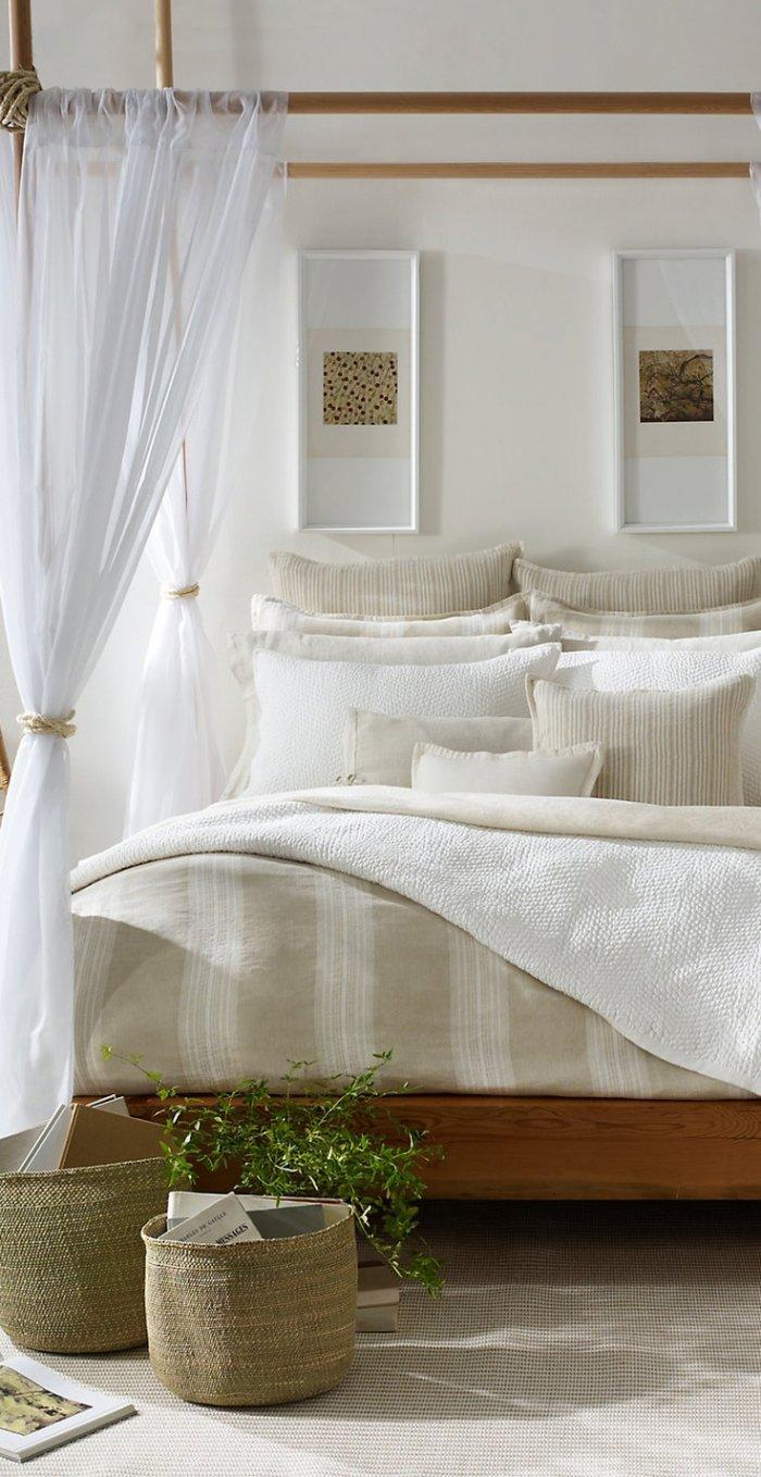 Traditional feng shui bedroom - with white walls and curtains
