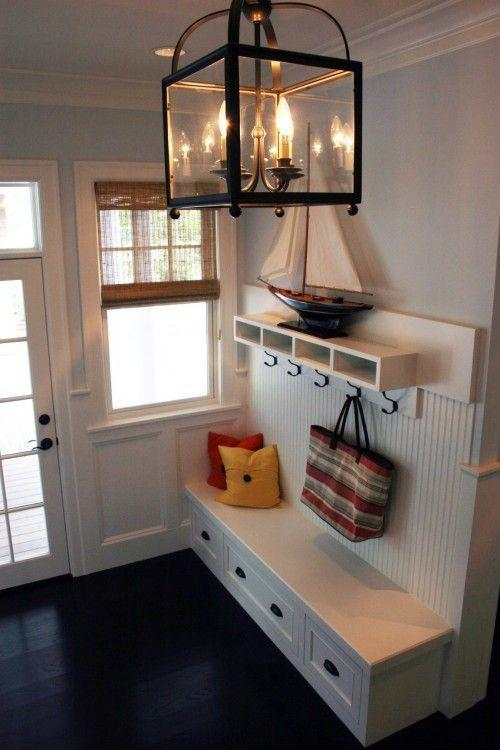 Traditional white entryway - with bench and drawers