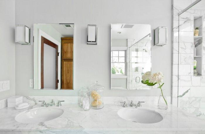 Two bathroom mirrors - placed in a large bath
