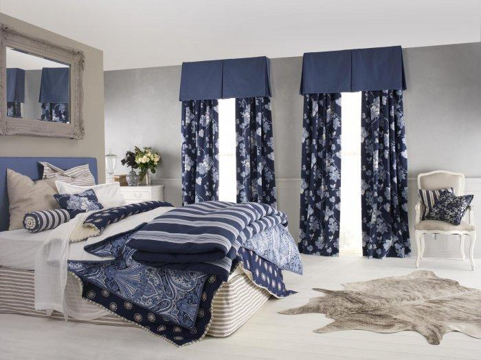 Two-colored curtains - inside a luxurious bedroom