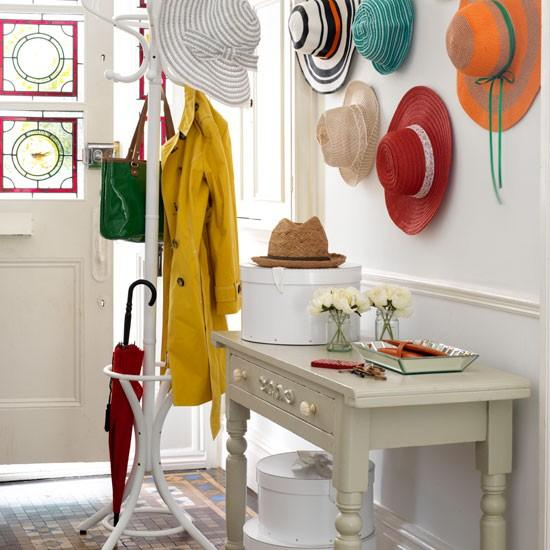 Vintage hallway table - and colorful hats above it