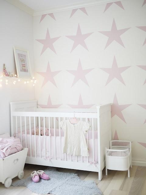 White and pink paint - with star decorations on the wall