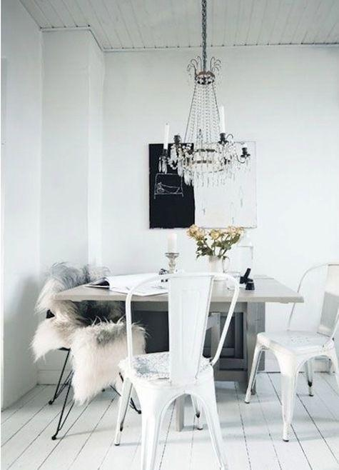 White eclectic dining room - with classic chandelier and modern furniture