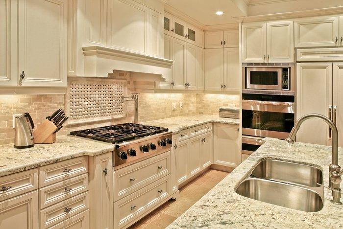 White kitchen with granite countertops - traditional luxurious kitchen interior