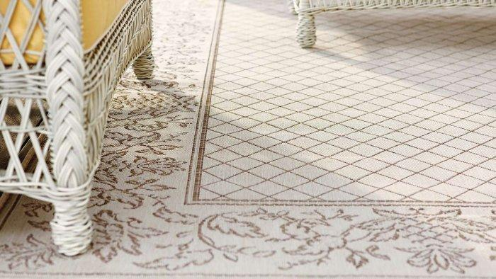 White outdoor rug - with various ornaments