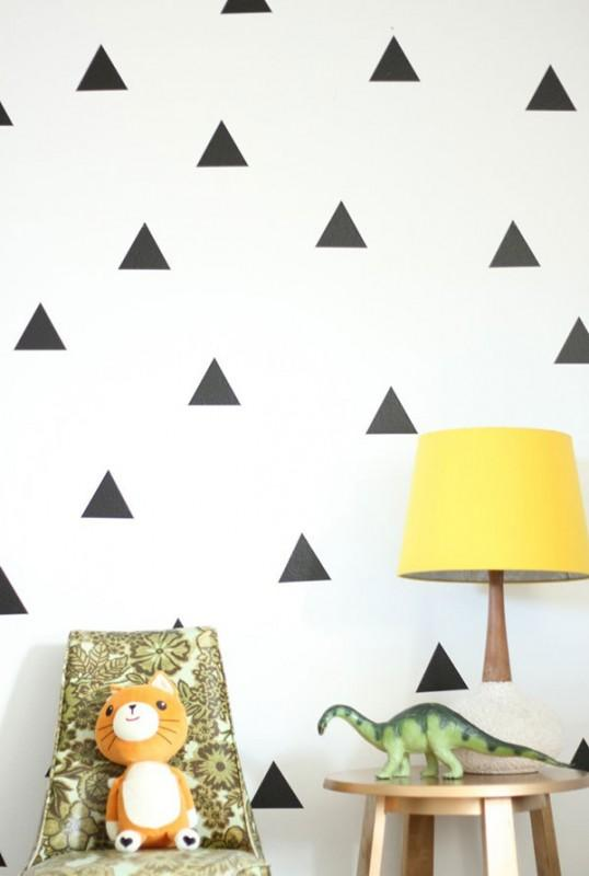 White paing and black triangles - creative decor in apartment
