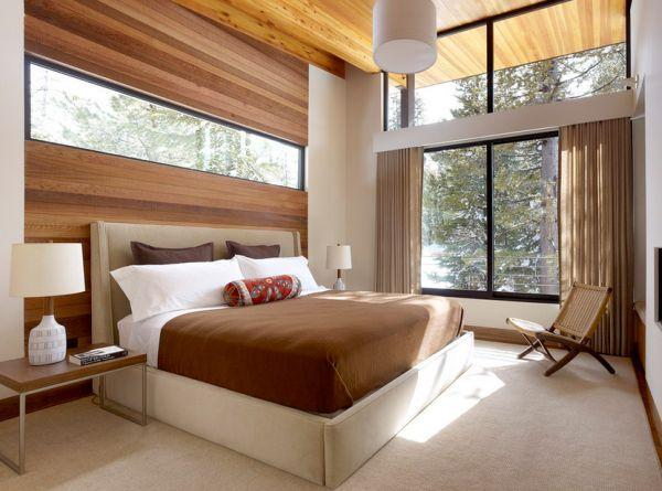 Wooden inspired feng shui bedroom - with brown nuances and a lot of windows